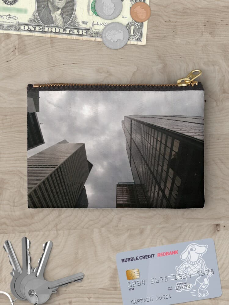 Tower in the city zipper pouch on Redbubble by someartworker
